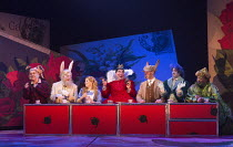 l-r: Joanna Marie Skillett (Dormouse),  James Cleverton (Rabbit), Fflur Wyn (Alice), Robert Burt (Red Queen), John Lofthouse (March Hare), Magid El-Bushra (Cheshire Cat), Keel Watson (Caterpillar) in...