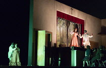 PAGLIACCI   by Leoncavallo  conductor: Antonio Pappano   set design: Paolo Fantin   costumes: Carla Teti   lighting: Alessandro Carletti   director: Damiano Michieletto at left, outside the theatre: B...