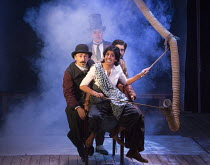 AROUND THE WORLD IN 80 DAYS   by Jules Verne   adapted by Laura Eason   design: Anna Fleischle   lighting: Chris Davey   director: Lucy Bailey   front: Lena Kaur (Miss Singh)   middle, l-r: Simon Greg...