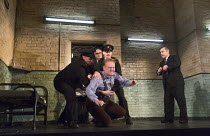 the condemned man puts up a struggle - front left: Josef Davies (Hennessy)  right: Andy Nyman (Syd) in HANGMEN by Martin McDonagh director: Matthew Dunster design: Anna Fleischle lighting: Joshua Carr...
