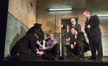 Harry reasons with the condemned man - front l-r: Josef Davies (Hennessy - in blue shirt), David Morrissey (Harry), Andy Nyman (Syd) in HANGMEN by Martin McDonagh director: Matthew Dunster design: Ann...