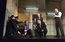 Syd tries reasoning with the condemned man - front, l-r: Josef Davies (Hennessy - in blue shirt), Andy Nyman (Syd), David Morrissey (Harry) in HANGMEN by Martin McDonagh director: Matthew Dunster desi...