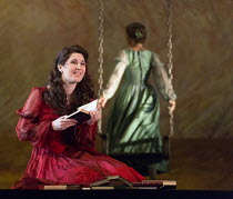 Nicole Car (Tatyana) with Oskana Volkova (Olga) in EUGENE ONEGIN by Tchaikovsky opening at The Royal Opera, Covent Garden, London WC2 on 19/12/2015   conductor: Semyon Bychkov set design: Mia Stensgaa...