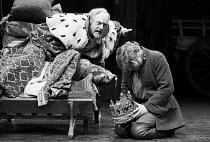 HENRY IV pt.ii by Shakespeare   set design: John Collins   costumes: Elizabeth Haffenden & Joan Bridge   lighting: David Adams   director: Ron Pember   l-r: Graham Crowden (Henry IV), Hywel Bennett (P...