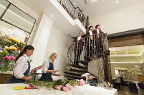 FOUND & LOST an opera music: Emily Hall libretto: Matthew Welton director: Lucy Bradley  (on stairs) Siglo de Oro Choir with hotel floristsa promenade  performance at the Corinthia Hotel, Northumberla...
