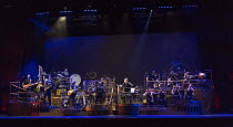 left: The Black Smoke Band  centre: Jeff Wayne  right: the ULLAdubULLa String Orchestra in THE WAR OF THE WORLDS adapted by Doreen Wayne after H G Wells music: Jeff Wayne opening at the Dominion Theat...