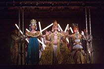 Coronation of Akhnaten, the new Pharaoh - l-r: Emma Carrington (Nefertiti), Anthony Roth Costanzo (Akhnaten), Rebecca Bottone (Queen Tye) in AKHNATEN by Philip Glass opening at English National Opera...