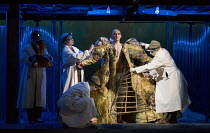 dressing the body of Akhnaten: Anthony Roth Costanzo (Akhnaten) in AKHNATEN by Philip Glass opening at English National Opera (ENO), London Coliseum WC2 on 04/03/2016 in association with Improbable  a...