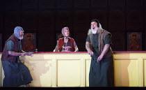 scene 4, the inn - l-r: Harry Nicoll (Missail), Rebecca de Pont Davies (Hostess of the Inn), John Tomlinson (Varlaam) in BORIS GODUNOV by Musorgsky (after Pushkin) opening at the The Royal Opera House...