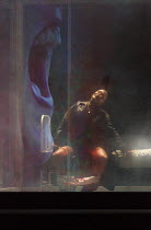 PARSIFAL   by Wagner   conductor: Antonio Pappano   design: Alison Chitty   lighting: Paul Pyant   director: Stephen Langridge   Act 1 - seen through screen panel of onstage box - Klingsor has castra...