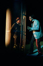 TWELFTH NIGHT by Shakespeare design: Huntley/Muir lighting: Alan Burrett director: David Pountney Malvolio imprisoned - l-r: Richard Durden (Malvolio), Brian Capron (Feste)Nottingham Playhouse, Nottin...