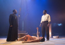 l-r: Gary Beadle (Abioseh Matoseh), Tunji Kasim (Eric), Danny Sapani (Tshembe Matoseh) in LES BLANCS (The Whites) by Lorraine Hansberry opening in the Olivier Theatre, National Theatre (NT), London SE...