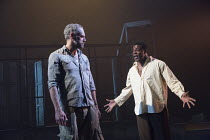 l-r: Elliot Cowan (Charlie Morris), Danny Sapani (Tshembe Matoseh) in LES BLANCS (The Whites) by Lorraine Hansberry opening in the Olivier Theatre, National Theatre (NT), London SE1 on 30/03/2016   de...