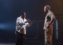 l-r: Danny Sapani (Tshembe Matoseh), Elliot Cowan (Charlie Morris) in LES BLANCS (The Whites) by Lorraine Hansberry opening in the Olivier Theatre, National Theatre (NT), London SE1 on 30/03/2016   de...