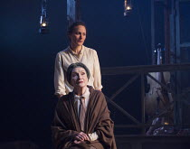 (seated) Sian Phillips (Madame Neilsen), Anna Madely (Dr Marta Gotterling) in LES BLANCS (The Whites) by Lorraine Hansberry opening in the Olivier Theatre, National Theatre (NT), London SE1 on 30/03/2...