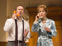 Jason Merrells (Bob Phillips), Jenny Seagrove (Fiona Foster) in HOW THE OTHER HALF LOVES by Alan Ayckbourn opening at the Theatre Royal Haymarket, London SW1 on 31/03/2016 design: Julie Godfrey lighti...