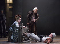 l-r: Joshua Elliott (Fool), Michael Pennington (King Lear), Tom McGovern (Kent - in disguise, in the stocks) in KING LEAR by Shakespeare opening at the Theatre Royal, Royal & Derngate, Northampton on...
