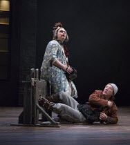 l-r:  Joshua Elliott (Fool), Tom McGovern (Kent - in disguise, in the stocks) in KING LEAR by Shakespeare opening at the Theatre Royal, Royal & Derngate, Northampton on 05/04/2016  in association with...