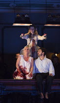 Act 3, scene 2 - l-r: Diana Damrau (Lucia), Sacha Plaige (ghost of a murdered Lammermoor girl), Charles Castronovo (Edgardo Ravenswood) in LUCIA DI LAMMERMOOR music by Donizetti opening at The Royal O...