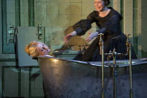 Act 3, scene 3 - Alisa finds Lucia dead, l-r: Diana Damrau (Lucia), Rachael Lloyd (Alisa) in LUCIA DI LAMMERMOOR music by Donizetti opening at The Royal Opera House, Covent Garden, London WC2 on 07/04...