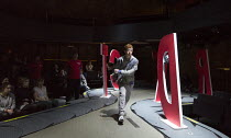 Frankie Fox (Liam - walking between giant letters spelling Sports Direct) in BOY by Leo Butler opening at the Almeida Theatre, London N1 on 12/04/2016  set design: Miriam Buether costumes: Ultz lighti...