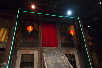 THE SUGAR-COATED BULLETS OF THE BOURGEOISIE by Anders Lustgarten design: Lily Arnold lighting: Elliot Griggs director: Steven Atkinson   stage,set,full,empty,China,Chinese,lanterns,neon,strip co-produ...
