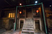 THE SUGAR-COATED BULLETS OF THE BOURGEOISIE by Anders Lustgarten design: Lily Arnold lighting: Elliot Griggs director: Steven Atkinson   stage,set,full,empty,China,Chinese,lanterns,water,tap,fluoresce...