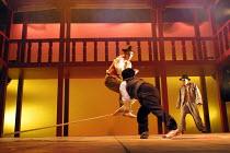 ROMEO AND JULIET by Shakespeare design: Elroy Ashmore directors: Alasdair Ramsay & Paul Courtenay Hyu   III:i - Tybalt and Mercutio fight - (front) Paul Chan (Tybalt), (jumping) Daniel York (Mercutio)...