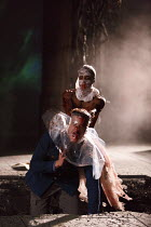 CYMBELINE by Shakespeare design: Anna Fleischle lighting: Philip Gladwell director: Melly Still V/ii - Posthumus attacks Iachimo: (rear) Hiran Abeysekera (Posthumus), Oliver Johnstone (Iachimo)Royal S...