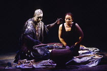 ANTONY AND CLEOPATRA by Shakespeare design: Sue Blane lighting: David Hersey director: John Caird   the Soothsayer reveals the asp: Jasper Britton (Soothsayer), Clare Higgins (Cleopatra)  Royal Shakes...