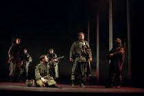 HENRY V   by Shakespeare   design: Ashley Martin-Davies   lighting: Peter Mumford   director: Ron Daniels     IV/iii - St Crispin's Day speech - kneeling: Jon Fenner (Duke of Bedford), centre: Michae...