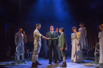 the handshake - centre, l-r: Stuart Ward (Ted), Michael Crawford (Leo Colston), William Thompson (young Leo) watched by Issy Van Randwyck (Mrs Maudsley) and (far right) Gemma Sutton (Marian) in THE GO...