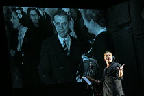 making a recording studio voice over, projected image of Jean-Paul Sarte & Simone de Beauvoir: Marc Labreche (Robert) in NEEDLES AND OPIUM written & directed by Robert Lepage opening at the Barbican T...