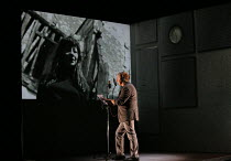 making a recording studio voice over, projected image of Juliette Greco: Marc Labreche (Robert) in NEEDLES AND OPIUM written & directed by Robert Lepage opening at the Barbican Theatre, Barbican Centr...