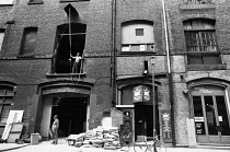 exterior of the RSC Warehouse during construction in 1977. Previously a vat room, hops warehouse, film studio and banana ripening depot prior to purchase by Donald Albery in1961 for use as a private r...