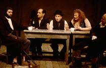 BAAL by Bertolt Brecht design: Ralph Koltai lighting: Leo Leibovici director: David Jones   l-r: Clyde Pollitt (Old Beggar), Ben Kingsley (Baal), Timothy Spall (Nech / Bolle), Lila Kaye (Landlady / Ma...