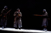SCHWEYK IN THE SECOND WORLD WAR   by Bertolt Brecht   set design: William Dudley   costumes: Lindy Hemming   lighting: William Bundy   director: Richard Eyre   centre: Bill Paterson (Schweyk) Olivier...