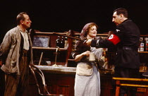 SCHWEYK IN THE SECOND WORLD WAR   by Bertolt Brecht   set design: William Dudley   costumes: Lindy Hemming   lighting: William Bundy   director: Richard Eyre   l-r: Bill Paterson (Schweyk), Julia McKe...
