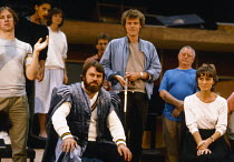 seated, front: Brian Blessed (Claudius), Virginia McKenna (Gertrude) in rehearsal for the 1984 Royal Shakespeare Company (RSC) production of HAMLET  design: Maria Bjornson lighting: Chris Ellis fights...