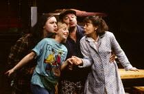 INVISIBLE FRIENDS by Alan Ayckbourn design: Roger Glossop lighting: Mick Hughes director: Alan Ayckbourn l-r: Mark Benton (Gary), Emma Chambers (Lucy Baines), Bill Moody (Walt), Janet Dale (Joy)Cottes...