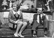 ENTERTAINING MR SLOANE by Joe Orton design: Saul Radomsky lighting: Mark Mumford director: Kenneth Williams ~~Barbara Windsor (Kath), Dave King (Ed)~Lyric Hammersmith, London W6  18/03/1981...