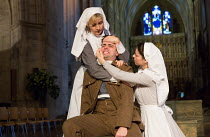 l-r: Louise Templeton (Matron), Rhys Bevan (Henry V), Floriane Andersen (Nurse) in HENRY V by Shakespeare opening at Southwark Cathedral, London SE1 on 03/02/2017   an Antic Disposition production des...