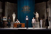 reading the indictment at Hermione's trial - front centre, l-r: Iain Paterson (Leontes), Anthony Gregory (Court Official), Sophie Bevan (Hermione) in THE WINTER'S TALE opening at English National Oper...