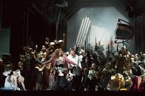 the Act 2 riot - front left: Gwyn Hughes Jones (Walther von Stolzing), Rachel Willis-Sorensen (Eva), Bryn Terfel (Hans Sachs) in DIE MEISTERSINGER VON NURNBERG (The Mastersingers) by Wagner opening at...