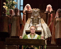 Act 3, the contest: Johannes Martin Kranzle (Sixtus Beckmesser) with (rear, seated) Eva in DIE MEISTERSINGER VON NURNBERG (The Mastersingers) by Wagner opening at The Royal Opera, Covent Garden, Londo...