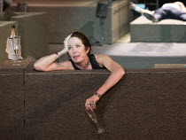 in despair: Chris Nietvelt (Cleopatra) with Antony's body in background in ANTONY AND CLEOPATRA opening at the Barbican Theatre, Barbican Centre, London EC2 on 17/03/2017 a Toneelgroep, Amsterdam prod...