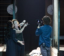 final scene, l-r: Marieke Heebink (Charmian), Chris Nietvelt (Cleopatra - handling snake) with the body of Antony (bottom) and video camera operator in ANTONY AND CLEOPATRA opening at the Barbican The...