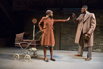 Babirye Bukilwa (Rosa), Tunji Lucas (Walter) in FILTHY BUSINESS by Ryan Craig opening at Hampstead Theatre (HT), London NW3 on 16/03/2017   design: Ashley Martin-Davis lighting: Rick Fisher director:...