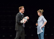 l-r: Adam James (Jake - holding baby, Misha Wakefield-Raine, playwright's son), Anna Maxwell Martin (Kitty) in CONSENT by Nina Raine opening at the Dorfman Theatre, National Theatre (NT), London SE1 o...