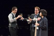 l-r: Ben Chaplin (Edward), Adam James (Jake - holding baby, Misha Wakefield-Raine, playwright's son), Priyanga Burford (Rachel) in CONSENT by Nina Raine opening at the Dorfman Theatre, National Theatr...